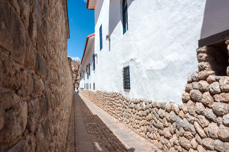 peru architecture: Narrow street alley in Cuzco, Peru with Incan stonework and colonial architecture visible