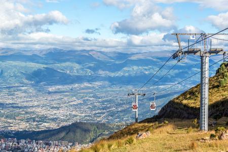 View of a gondola named the TeleferiQo climbing the Andes mountains outside of Quito, Ecuador