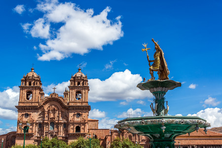 cuzco: Church and Incan fountain in the Plaza de Armas of Cusco, Peru Stock Photo