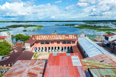 amazon river: View of Iquitos, Peru with the Itaya River in the background in the Amazon Rainforest.  Iquitos is the largest city in the world with no road connection. Stock Photo