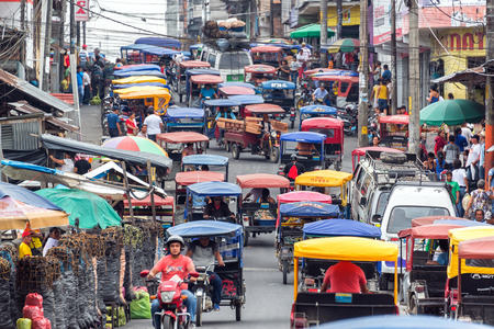 mototaxi: IQUITOS, PERU - MARCH 17: Heavy traffic in the Belen market in Iquitos, Peru on March 17, 2015 Editorial