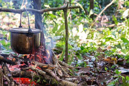 cooking pot: Cooking food at a campsite deep within the Amazon rainforest in Peru Stock Photo