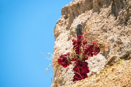 catholocism: Cross covered in flowers inside of Colca Canyon in Peru
