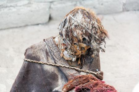 mummified: Closeup of one of the mummies of the ancient Chauchilla culture in Nazca, Peru