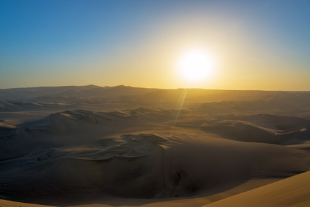 oasis at sunrise: Sunset over the sand dune at Huacachina, Peru