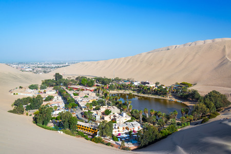 Oasis of Huacachina with Ica, Peru in the background