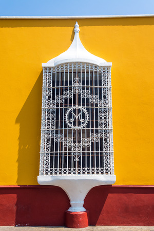 peru architecture: Yellow and red colonial architecture in the historic center of Trujillo Peru