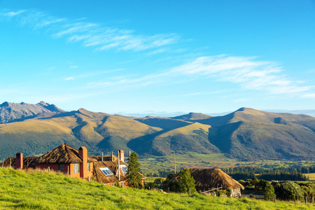 colonial building: Old colonial building and stunning landscape near Cotopaxi Volcano in Ecuador Stock Photo
