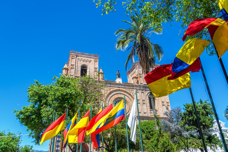 Flags waving in front of the cathedral in the historic center of Cuenca Ecuador