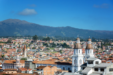 colonial church: Cityscape of Cuenca Ecuador with Santo Domingo church visible in the bottom right Stock Photo