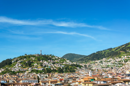 poverty: View of the historic center of Quito Ecuador with rolling hills in the background