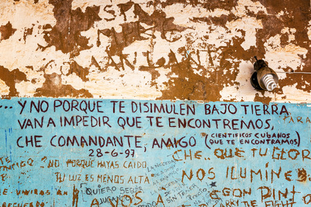argentinean: VALLEGRANDE BOLIVIA  AUGUST 6:  Graffiti in the laundromat where the body of Che Guevara was displayed in Vallegrande Bolivia seen on August 8 2014.  The graffiti is by the Cuban team that discovered his body Editorial