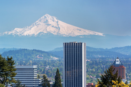 Skyscrapers in downtown Portland Oregon with Mount Hood rising above them
