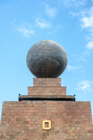 equator: Large metal globe on the top of the monument to the equator in Quito Ecuador