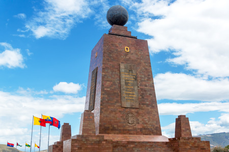 equator: Monument to the Equator in Quito Ecuador with the Ecuadorian flag in the bottom left Stock Photo