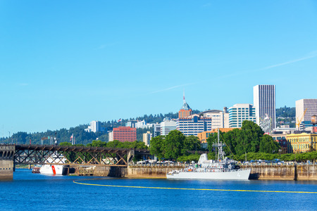 canadian military: PORTLAND OR  JUNE 7: Navy and Coast Guard ships on the waterfront of Portland Oregon during the Rose Festival on June 7 2015