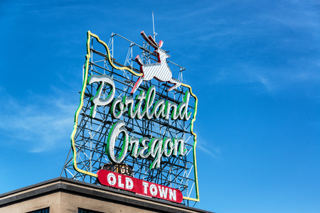 Iconic Portland Oregon Old Town sign with an outline of Oregon and a stag