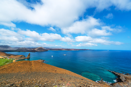 ecuador: Wide angle view of the Pacific Ocean around Bartolome Island with Pinnacle Rock on the left side in the Galapagos Islands in Ecuador
