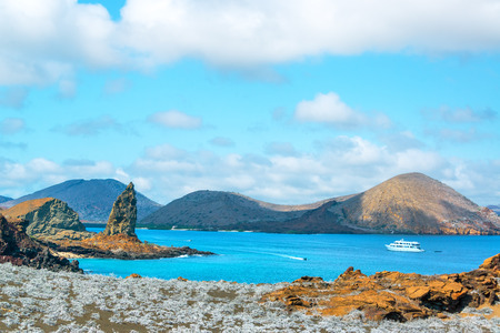 island: View of Pinnacle Rock and Sullivan Bay in the Galapagos Islands Stock Photo