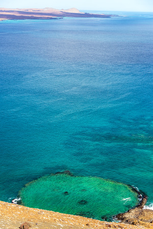 bartolome: Vertical view of an underwater crater in Bartolome Island in the Galapagos Islands in Ecuador Stock Photo