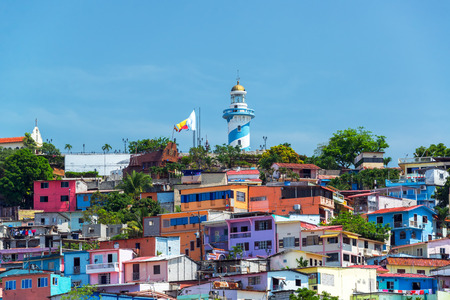 View of Santa Ana hill and the Las Penas neighborhood in Guayaquil, Ecuador with a lighthouse on top Banco de Imagens