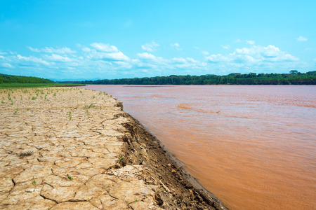 amazon river: Dry cracked earth at the bank of the Beni River in the Amazon rain forest in Bolivia Stock Photo