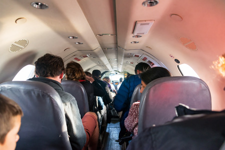 la paz: LA PAZ, BOLIVIA - AUGUST 27: Passengers inside the interior of a small airplane about to leave La Paz, Bolivia on August 27, 2014