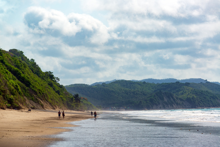 shore: Beach and lush green hills in Same, Ecuador