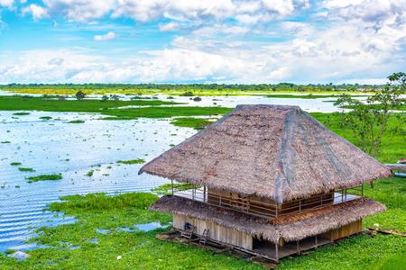 peru: Shack floating on a river in Iquitos, Peru