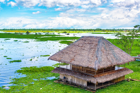 Shack floating on a river in Iquitos, Peru