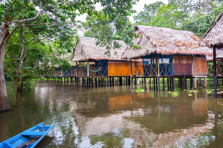 Bungalows in the Amazon rain forest in a flooded area on stilts near Iquitos, Peru