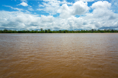 amazon river: View of the wide muddy Amazon River as it slowly passes through Peru Stock Photo
