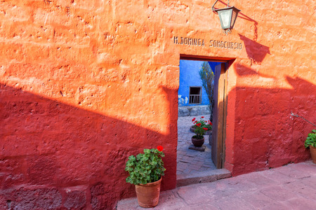 convent: Red wall in the Santa Catalina Monastery in Arequipa, Peru Stock Photo