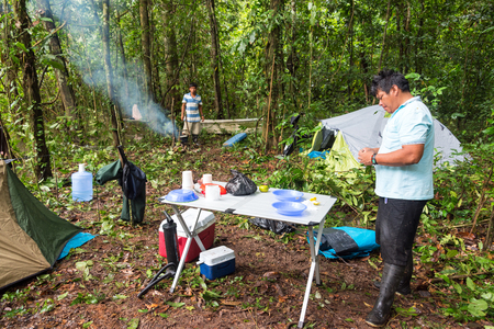 soup kettle: IQUITOS, PERU - MARCH 15: Early morning campsite view near Iquitos, Peru in the Amazon rain forest on March 15, 2015