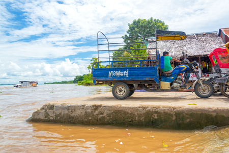 mototaxi: IQUITOS, PERU - MARCH 16: Rickshaws on the shore of the Amazon River near Iquitos, Peru on March 16, 2015 Editorial