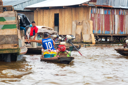 march 17: IQUITOS, PERU - MARCH 17: Floating market in the flooded Belen neighborhood of Iquitos, Peru on March 17, 2015 Editorial