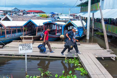 march 17: IQUITOS, PERU - MARCH 17: Passengers departing a boat in Iquitos, Peru on March 17, 2015 Editorial