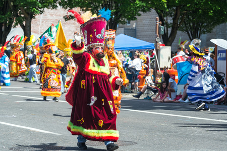 6 people: PORTLAND, OR - JUNE 6: People in traditional costumes from Mexico in the Grand Floral Parade in Portland, Oregon on June 6, 2015 Editorial