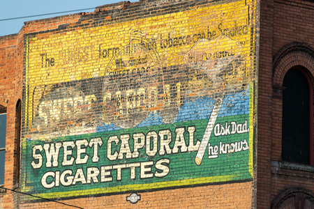 butte: BUTTE, MT - AUGUST 21: Old cigarette advertisement in Butte, MT on August 21, 2015