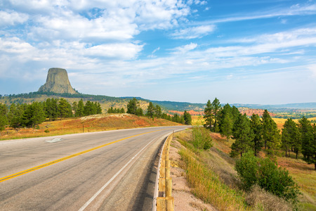 national monument: Devils Tower National Monument with a highway in Wyoming