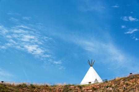 teepee: White teepee with a beautiful blue sky near Beulah, Wyoming