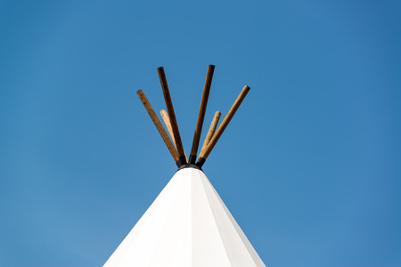 indian buffalo: Top of a teepee with a blue sky near Beulah, Wyoming Stock Photo