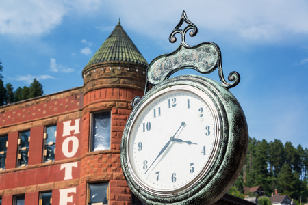 deadwood: Old historic clock in the old west town of Deadwood, South Dakota Editorial