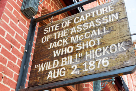 murdering: Sign marking the site where Jack McCall was captured after murdering Wild Bill Hickok