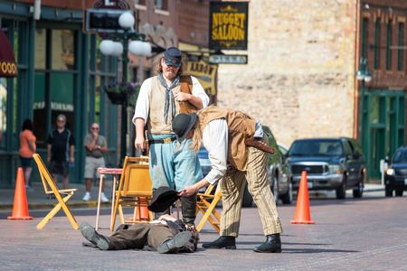 shootout: DEADWOOD, SD - AUGUST 26: Actors reenact a gunfight in Deadwood, SD on August 26, 2015 Editorial