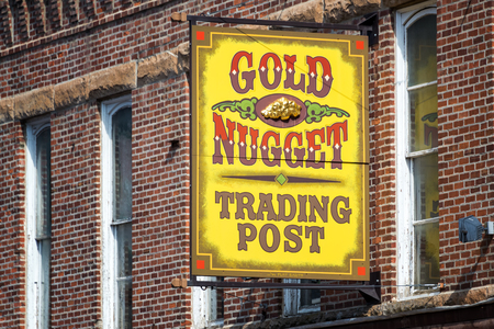deadwood: DEADWOOD, SD - AUGUST 26: Sign for a shop in the historic wild west town of Deadwood, SD on August 26, 2015
