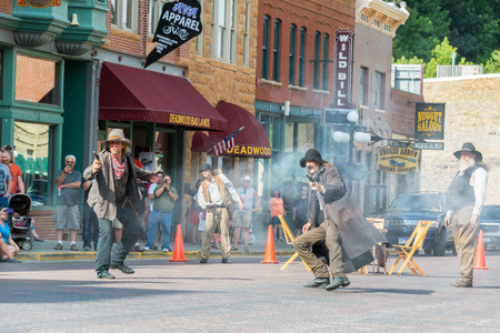 outlaw: DEADWOOD, SD - AUGUST 26: Actors reenact a historic gunfight in Deadwood, SD on August 26, 2015