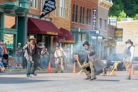 deadwood: DEADWOOD, SD - AUGUST 26: Actors reenact a historic gunfight in Deadwood, SD on August 26, 2015