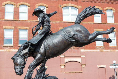 deadwood: DEADWOOD, SD - AUGUST 26: Statue of a cowboy on a horse in downtown Deadwood, SD on August 26, 2015 Editorial