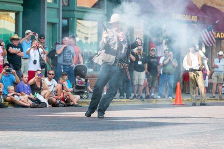 reenactment: DEADWOOD, SD - AUGUST 26: Reenactment of a gunfight in Deadwood, SD on August 26, 2015